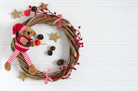 Handmade Christmas wreath with teddy bear. Overhead plane with space to write to the right. Stock Photo