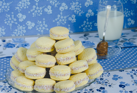 Caramel cookies on blue cloth background.
