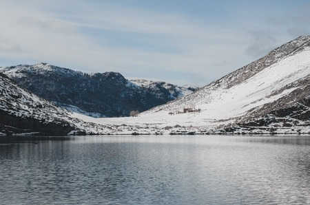 Covadonga lakes snowy landscape. Mountains and lakes.