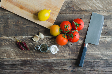 Ingredients and utensils for food preparation on aged wooden background. Top view.