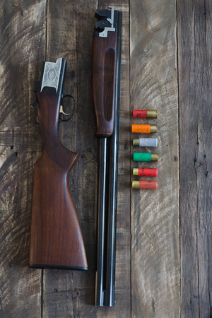 Shotgun of superimposed guns and cartridges.