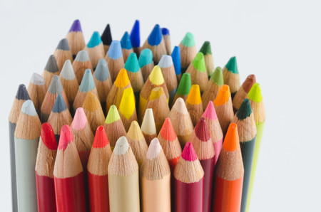 Group of colored pencils, tips. Yellow background.