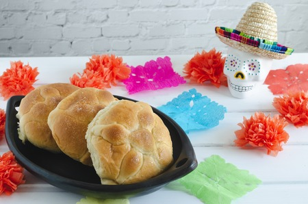 Mexican traditional celebration of the day of the dead. Bread of the dead. Wood background