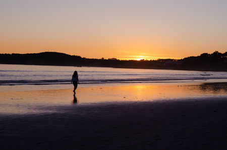 Woman walking on the beach of La Lanzada, O Grove, Pontevedra, Galicia, Spain. No people. Imagens