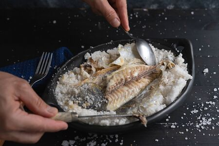 Be salt bream. Uncovering is fish after baking. Stok Fotoğraf
