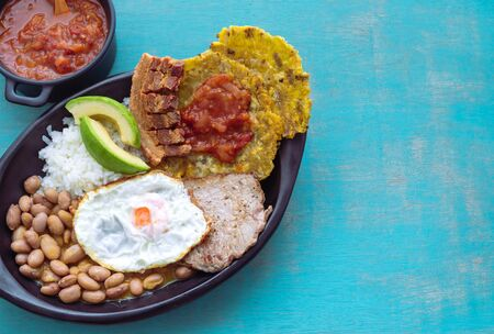 Bandeja paisa. Typical Colombian food. Concept of Colombian food. Copy space.