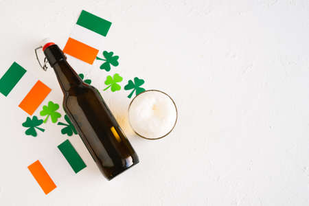 St. Patrick's Day Celebration. Beer decorated with Irish flags and shamrocks. Copy space. Top view.