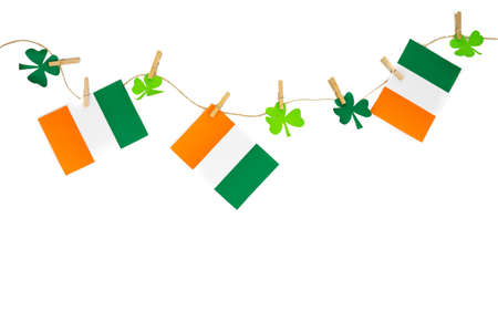 St. Patrick's Day garlands with flag and cloverleaf decorations. Copy space.