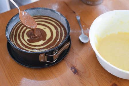 Marble sponge cake elaboration process. Copy space. Pastry.