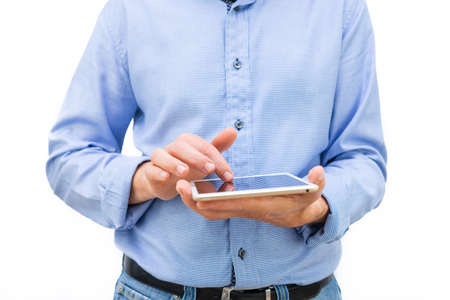 Man with tablet in hands and blue shirt on white background. Copy space.