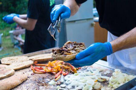 cook prepares an excellent patrami sandwich