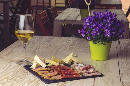 Italian appetizer with cheese, ham and prosecco