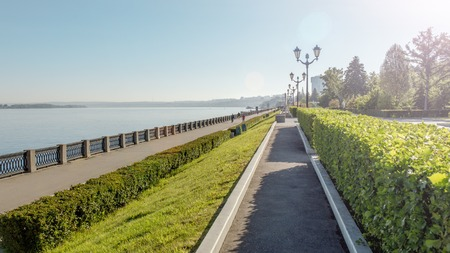 Samara, Russia - June 2017 - Volga River and the embankment of Samara, Russia. Samara embankment in summer. People having rest in the alley.