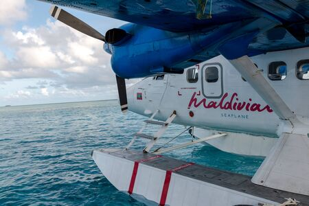 Seaplane is taking off at the airport in Maldives with beautiful sky