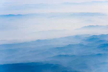 10,000 meters high altitude aerial view of the mountains and the sea of clouds