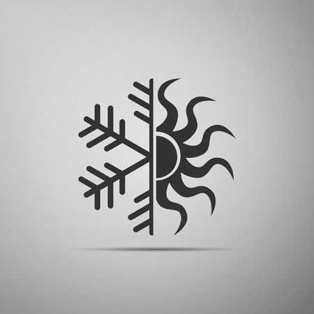 Hot and cold symbol. Sun and snowflake icon isolated on grey background. Winter and summer symbol. Flat design. Vector Illustration Illusztráció
