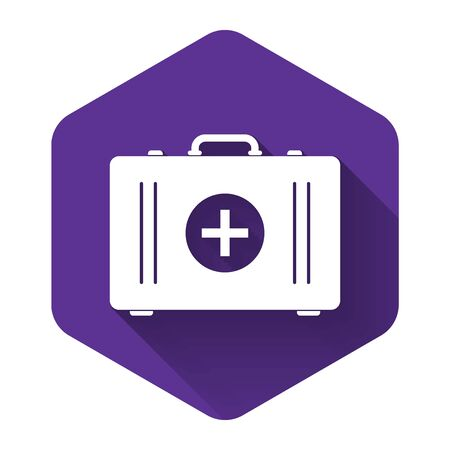White First aid kit icon isolated with long shadow. Medical box with cross. Medical equipment for emergency. Healthcare concept. Purple hexagon button. Vector Illustration
