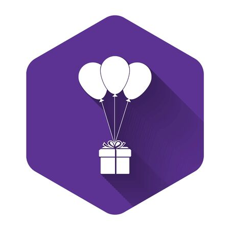 White Gift box with balloons icon isolated with long shadow. Purple hexagon button. Vector Illustration
