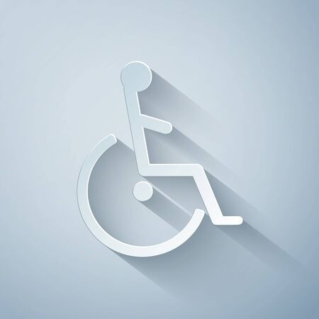Paper cut Disabled handicap icon isolated on grey background. Wheelchair handicap sign. Paper art style. Vector Illustration