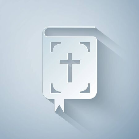 Paper cut Bible book icon isolated on grey background. Holy Bible book sign. Paper art style. Vector Illustration