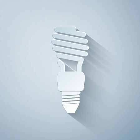Paper cut Energy saving light bulb icon isolated on grey background. Paper art style. Vector Illustration