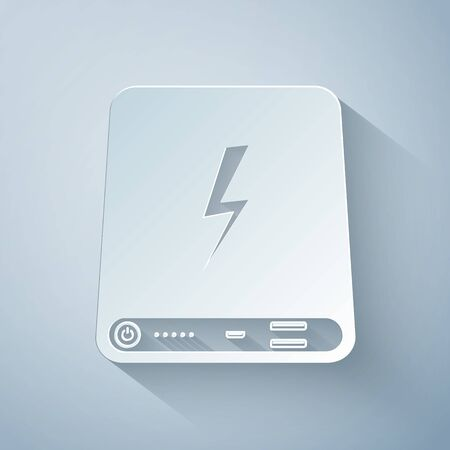 Paper cut Power bank icon isolated on grey background. Portable charging device. Paper art style. Vector Illustration 向量圖像