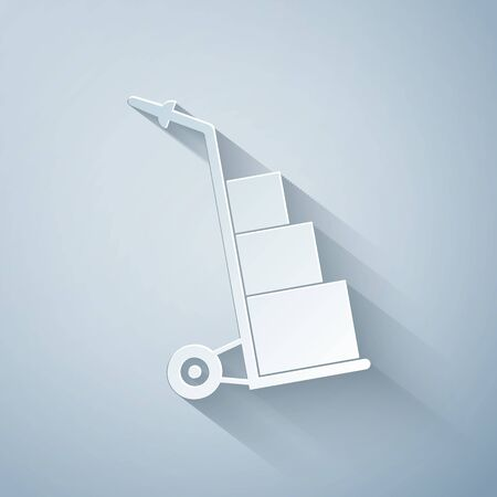 Paper cut Hand truck and boxes icon isolated on grey background. Dolly symbol. Paper art style. Vector Illustration