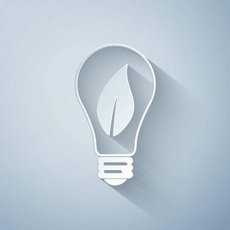 Paper cut Light bulb with leaf icon isolated on grey background. Eco energy concept. Paper art style. Vector Illustration