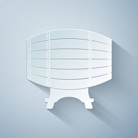 Paper cut Wooden barrel on rack icon isolated on grey background. Paper art style. Vector Illustration Stock Illustratie