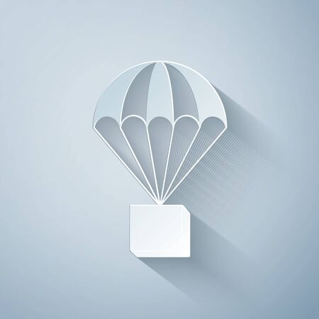 Paper cut Box flying on parachute icon isolated on grey background. Parcel with parachute for shipping. Delivery service, air shipping concept, bonus concept. Paper art style. Vector Illustration Ilustracja