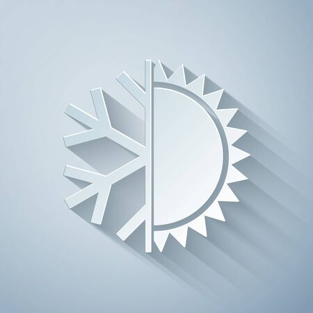 Paper cut Hot and cold symbol. Sun and snowflake icon isolated on grey background. Winter and summer symbol. Paper art style. Vector Illustration
