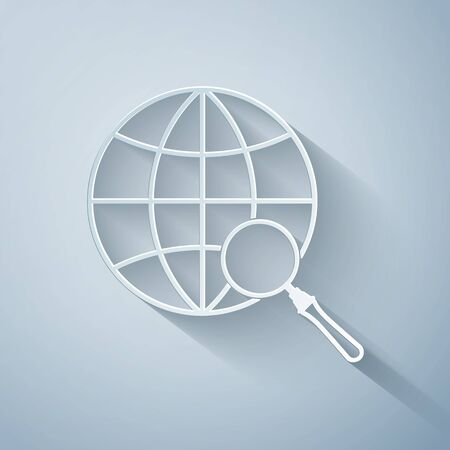 Paper cut Magnifying glass with globe icon isolated on grey background. Analyzing the world. Global search sign. Paper art style. Vector Illustration Ilustracja
