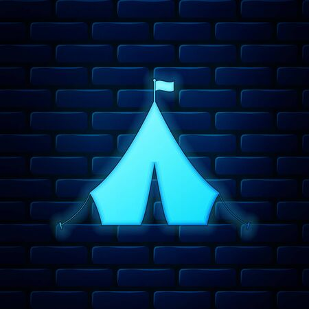 Glowing neon Tourist tent with flag icon isolated on brick wall background. Vector Illustration