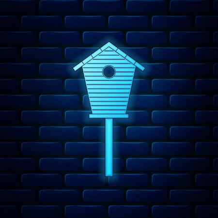 Glowing neon Bird house icon isolated on brick wall background. Nesting box birdhouse, homemade building for birds. Vector Illustration