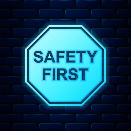 Glowing neon Safety First octagonal shape icon isolated on brick wall background. Vector Illustration Illustration