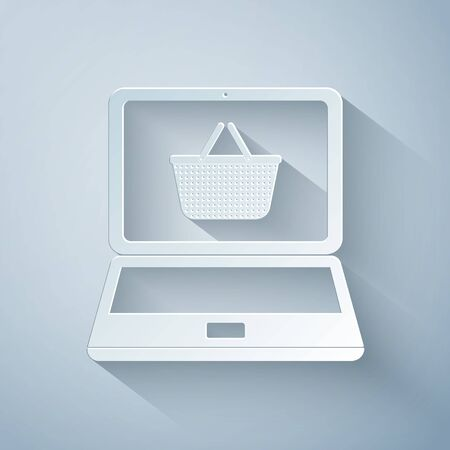 Paper cut Shopping basket on screen laptop icon isolated on grey background. Concept e-commerce, e-business, online business marketing. Paper art style. Vector Illustration Иллюстрация