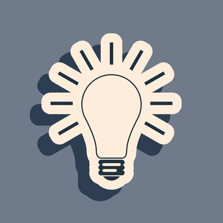 Black Light bulb with rays shine icon isolated on grey background. Energy and idea symbol. Lamp electric. Long shadow style. Vector Illustration