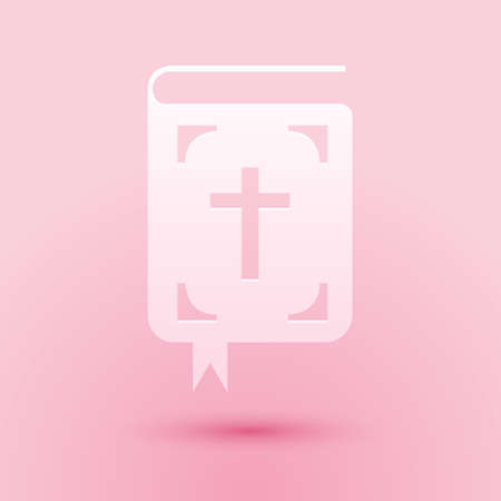 Paper cut Bible book icon isolated on pink background. Holy Bible book sign. Paper art style. Vector