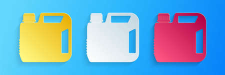 Paper cut Plastic canister for motor machine oil icon isolated on blue background. Oil gallon. Oil change service and repair. Engine oil sign. Paper art style. Vector
