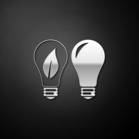 Silver Classic Lamp and Light bulb with leaf inside icon isolated on black background. Lighting electric lamp. Green eco energy concept. Long shadow style. Vector 向量圖像
