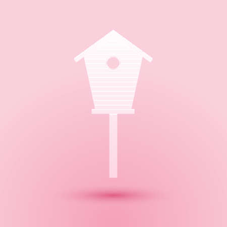 Paper cut Bird house icon isolated on pink background. Nesting box birdhouse, homemade building for birds. Paper art style. Vector
