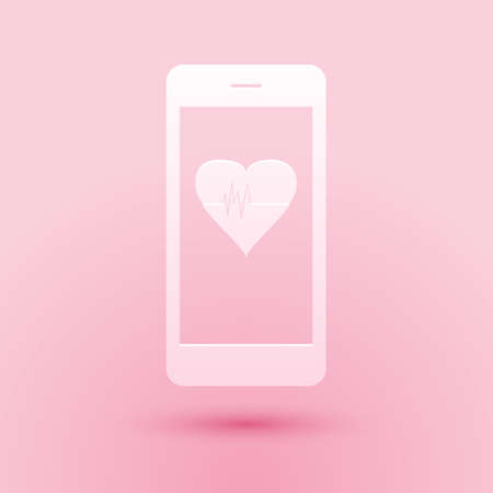 Paper cut Smartphone with heart rate monitor function icon isolated on pink background. Paper art style. Vector