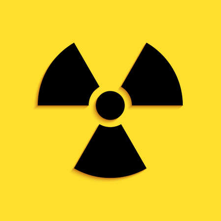 Black Radioactive icon isolated on yellow background. Radioactive toxic symbol. Radiation Hazard sign. Long shadow style. Vector