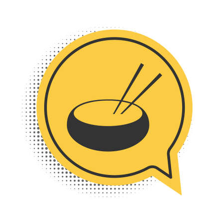 Black Bowl with asian food and pair of chopsticks silhouette icon isolated on white background. Concept of prepare, eastern diet. Yellow speech bubble symbol. Vector