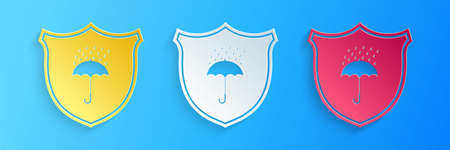 Paper cut Waterproof icon isolated on blue background. Shield and umbrella. Protection, safety, security concept. Water resistant symbol. Paper art style. Vector