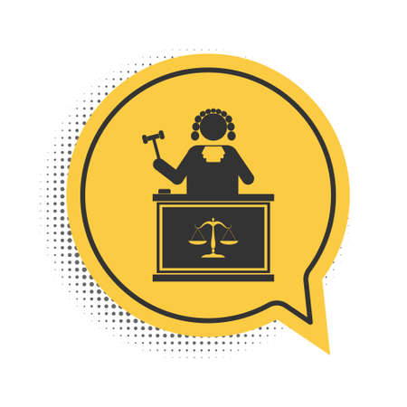Black Judge with gavel on table icon isolated on white background. Yellow speech bubble symbol. Vector