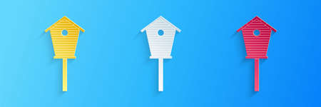 Paper cut Bird house icon isolated on blue background. Nesting box birdhouse, homemade building for birds. Paper art style. Vector Illustration