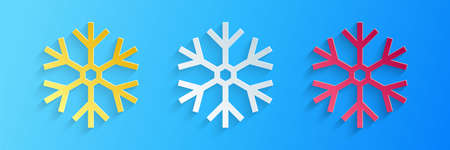 Paper cut Snowflake icon isolated on blue background. Paper art style. Vector