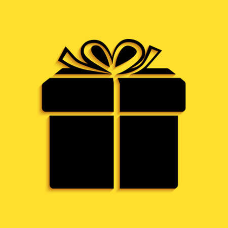 Black Gift box icon isolated on yellow background. Long shadow style. Vector