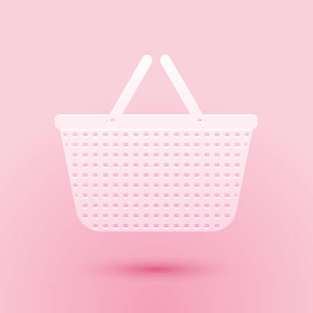 Paper cut Shopping basket icon isolated on pink background. Online buying concept. Delivery service sign. Shopping cart symbol. Paper art style. Vector Иллюстрация